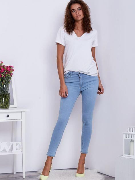 Jasnoniebieskie jeansowe spodnie ze stretchem                                   zdj.                                  4