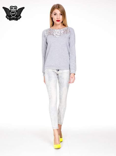 Jasnoniebieskie przecierane spodnie skinny jeans marmurki                                  zdj.                                  4