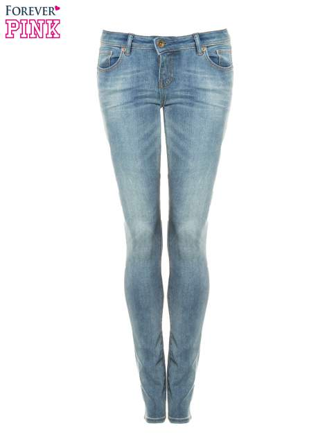 Jasnoniebieskie rozjaśniane spodnie jeansowe rurki                                   zdj.                                  5