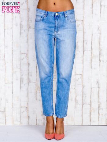 Jasnoniebieskie spodnie boyfriend jeans z przetarciami