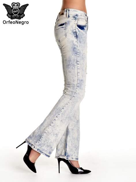 Jasnoniebieskie spodnie jeansowe dzwony z przetarciami                                  zdj.                                  3
