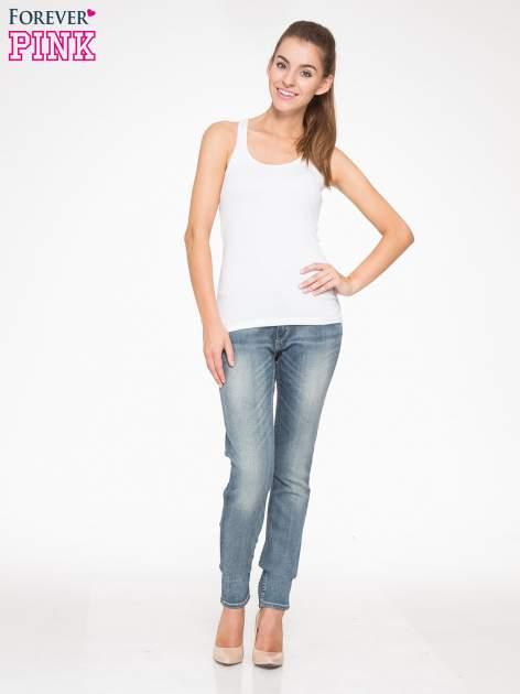 Jasnoniebieskie spodnie jeansowe rurki z cieniowaniem                                  zdj.                                  4