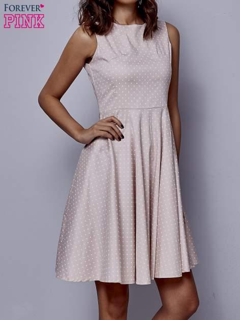 Jasnoróżowa rozkloszowana sukienka w groszki                                  zdj.                                  1