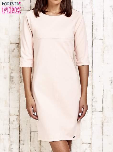 Jasnoróżowa sukienka dresowa z suwakiem z tyłu