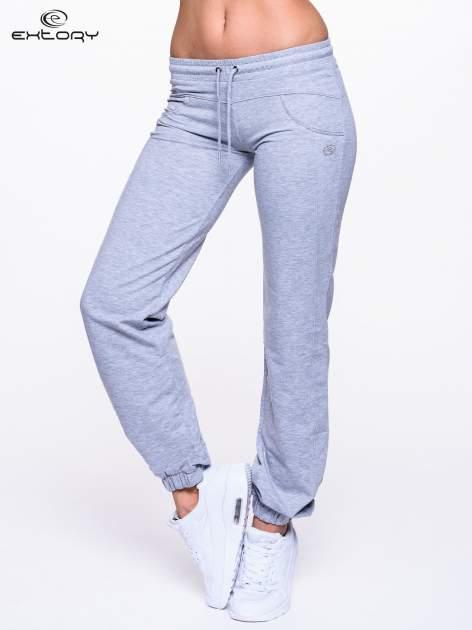 Jasnoszare spodnie dresowe ze ściągaczami                                  zdj.                                  1
