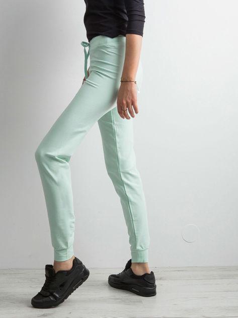 Jasnoturkusowe spodnie dresowe z troczkami                              zdj.                              3