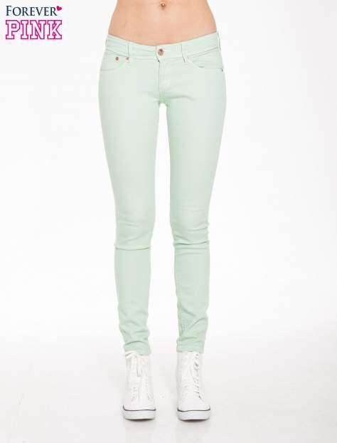 Jasnozielone spodnie jeansowe typu rurki