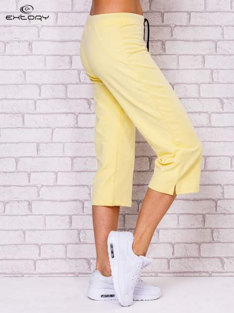 Jasnożółte spodnie sportowe capri                                  zdj.                                  2
