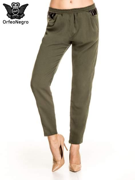 Khaki spodnie materiałowe ze skórzaną wstawką