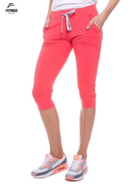 Koralowe sportowe spodnie za kolano typu capri