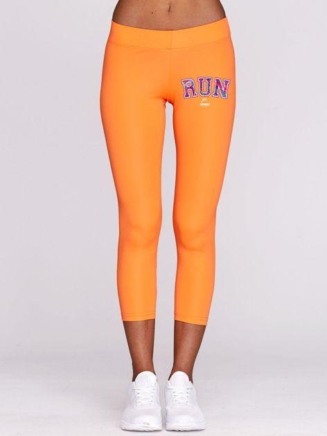 Legginsy do biegania z kolorową grafiką fluo pomarańczowe                                  zdj.                                  1