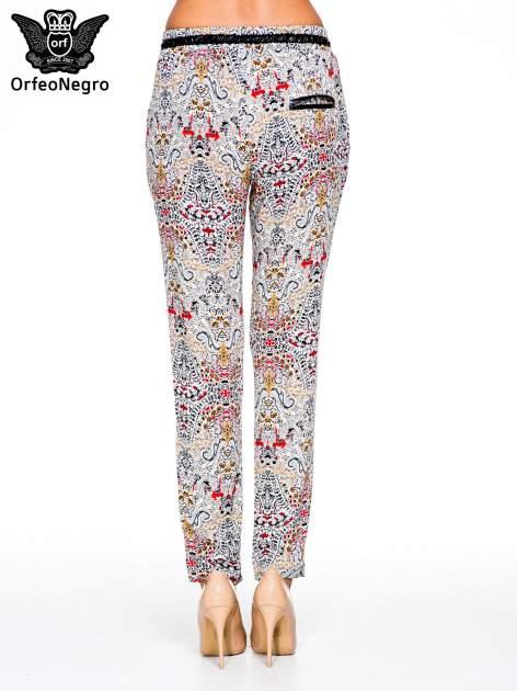 Lejące spodnie we wzór etno                                  zdj.                                  5