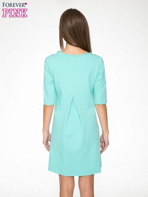 Miętowa sukienka z wydłużanymi bokami                                  zdj.                                  5