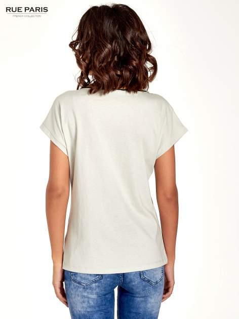 Miętowy t-shirt z siateczkową górą i kontrastową lamówką                                  zdj.                                  6