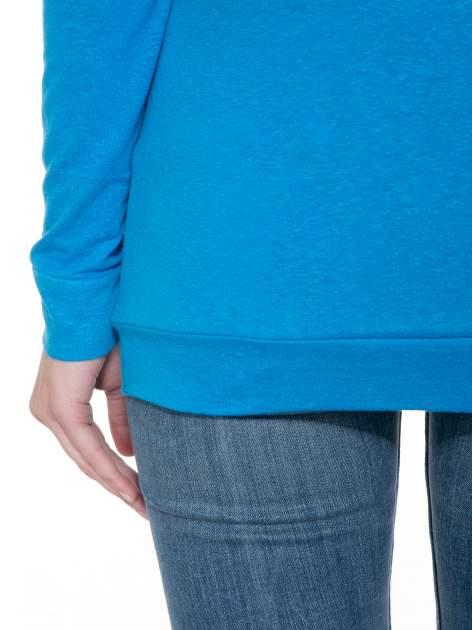 Niebieska bawełniana bluzka z rękawami typu reglan                                  zdj.                                  8