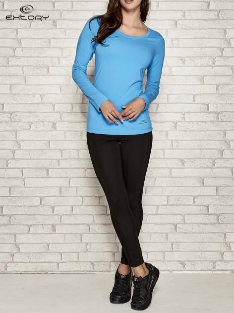 Niebieska gładka bluzka sportowa z dekoltem U PLUS SIZE                                  zdj.                                  2