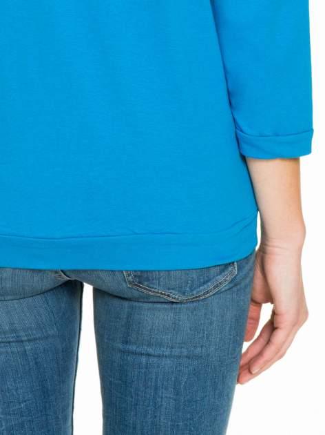 Niebieska gładka bluzka z luźnymi rękawami 3/4                                  zdj.                                  8