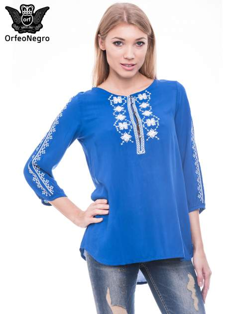 Niebieska luźna koszula z haftem                                  zdj.                                  1