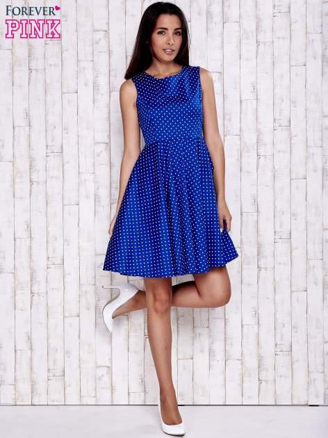 Niebieska rozkloszowana sukienka w groszki                                  zdj.                                  4
