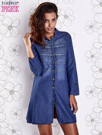 Niebieska sukienka jeansowa z plecionymi elementami                                  zdj.                                  3