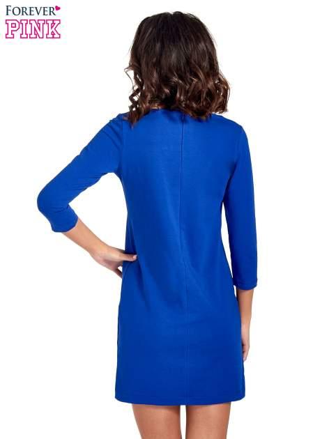 Niebieska sukienka ze złotymi suwakami                                  zdj.                                  4