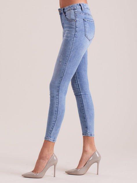 Niebieskie denimowe spodnie z aplikacją                              zdj.                              3