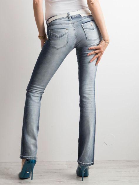Niebieskie jeansy bootcut                              zdj.                              2