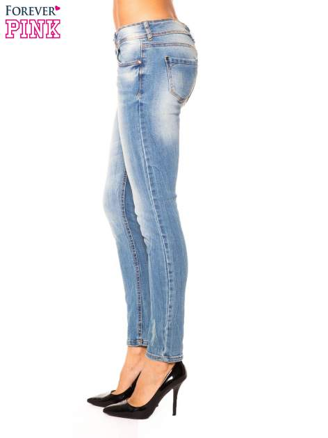 Niebieskie jeansy rurki wycierane                                  zdj.                                  6