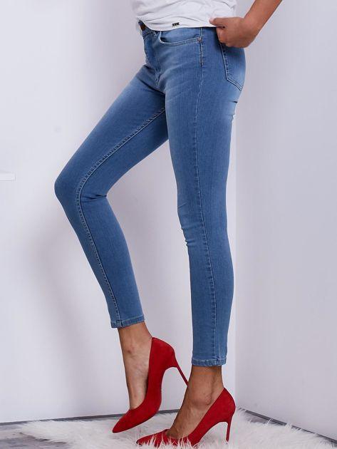 Niebieskie jeansy rurki z wysokim stanem                               zdj.                              3