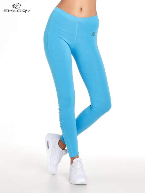 Niebieskie legginsy sportowe z drapowaniem                                  zdj.                                  1