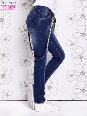 Niebieskie przecierane spodnie jeansowe z szelkami                                  zdj.                                  3