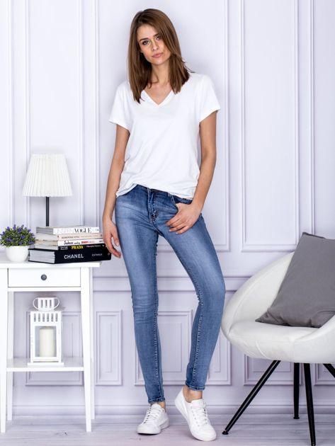 Niebieskie rozjaśniane jeansy rurki PLUS SIZE                                  zdj.                                  4