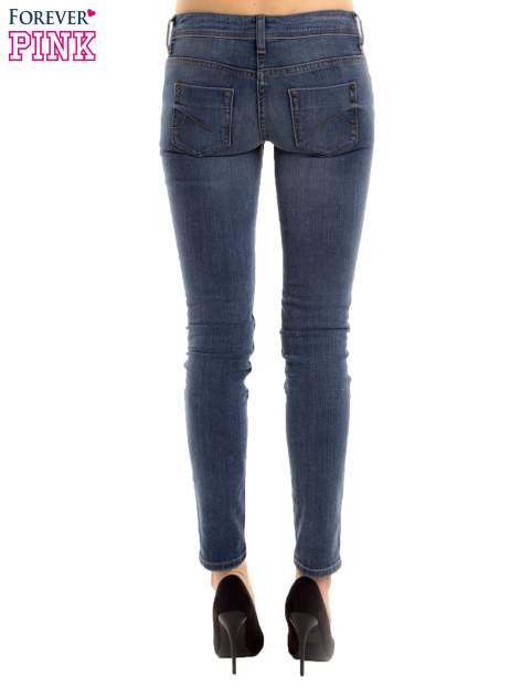 Niebieskie rurki skinny jeans                                  zdj.                                  4