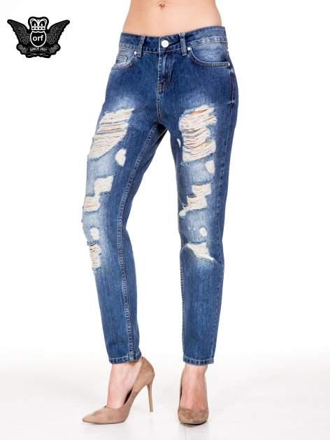 Niebieskie spodnie boyfriend jeans z rozdarciami                                  zdj.                                  1