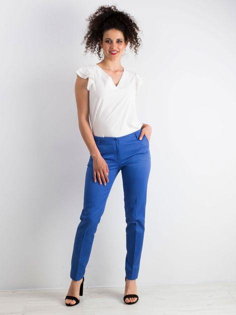 Niebieskie spodnie damskie o prostym kroju                              zdj.                              4