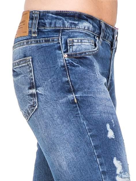 Niebieskie spodnie jeans 7/8 z dziurami i przetarciami                                  zdj.                                  8