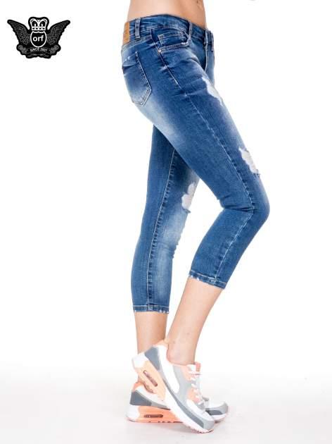 Niebieskie spodnie jeansowe do połowy łydki z przetarciami                                   zdj.                                  3