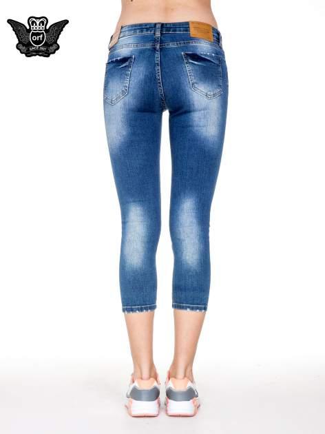 Niebieskie spodnie jeansowe do połowy łydki z przetarciami                                   zdj.                                  5