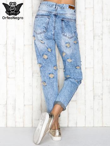 Niebieskie spodnie jeansowe marble denim z przetarciami