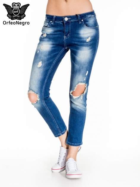 Niebieskie spodnie jeansowe rurki z dziurami na kolanach                                  zdj.                                  1