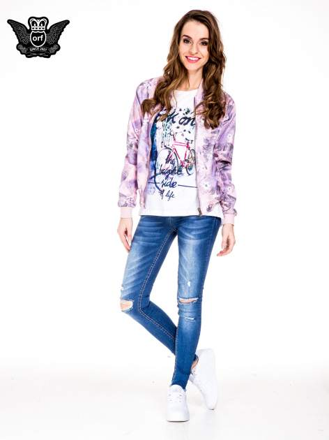 Niebieskie spodnie jeansowe rurki z rozjaśnianą nogawką i rozdarciami na kolanach                                  zdj.                                  2