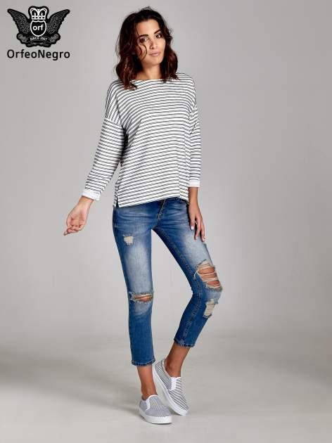 Niebieskie spodnie jeansowe skinny 7/8 z dziuarmi na kolanach                                  zdj.                                  2
