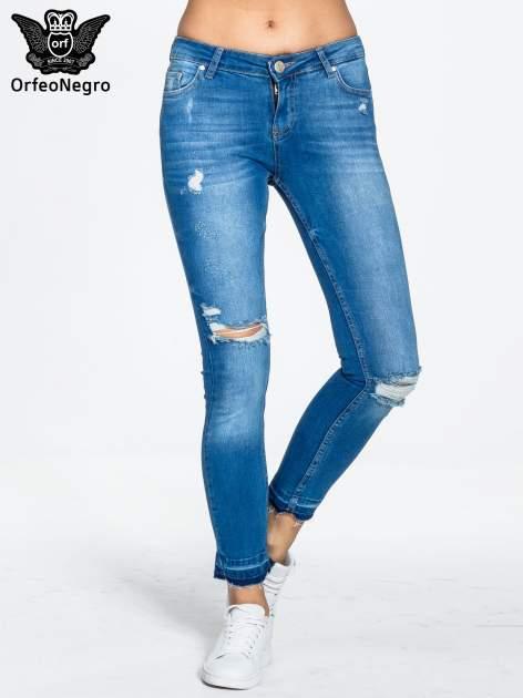 Niebieskie spodnie jeansowe skinny z dziurami na kolanach                                  zdj.                                  1