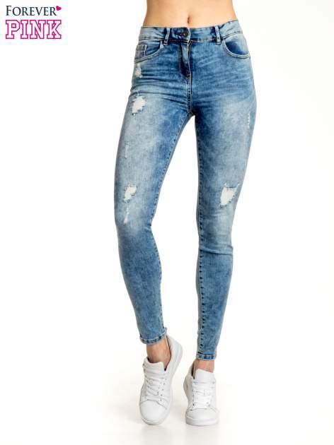 Niebieskie spodnie jeansowe skinny z przetarciami                                  zdj.                                  1