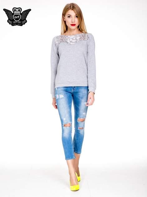 Niebieskie spodnie skinny jeans 7/8 z dziurami i przetarciami                                  zdj.                                  2