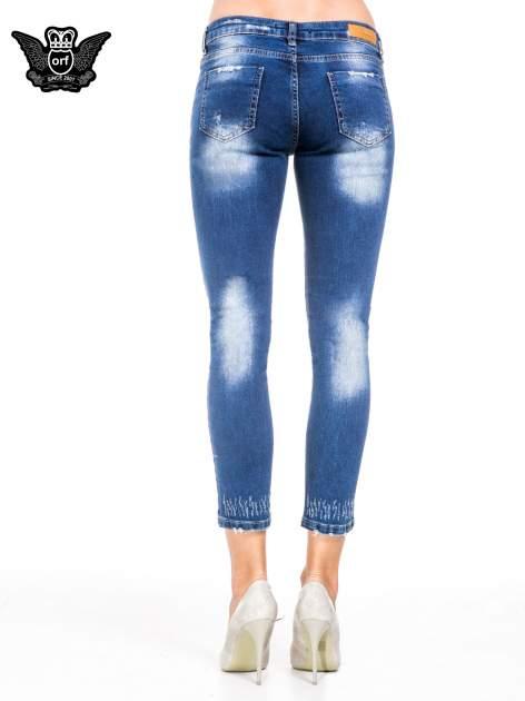 Niebieskie spodnie skinny jeans z cieniowaniem i przetarciami z przodu                                  zdj.                                  5