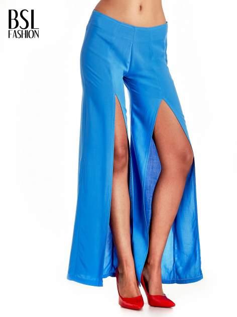 Niebieskie szerokie dzwony culottes z rozcięciami                                  zdj.                                  1