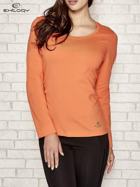 Pomarańczowa bluzka sportowa z dekoltem U