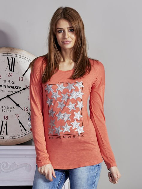 Pomarańczowa bluzka z nadrukiem cekinowych gwiazd                              zdj.                              1