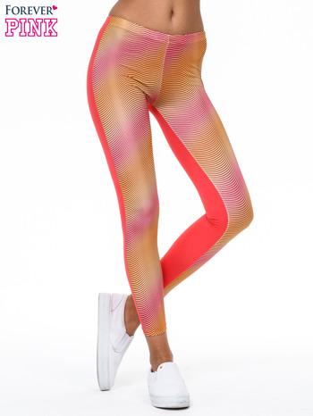 Pomarańczowe legginsy we fluorescencyjne wzory                                  zdj.                                  1